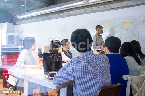496441730istockphoto Group of Business People Working on meeting 1004195860