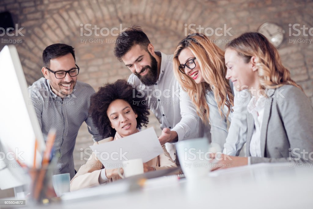 Group of business people working on project in modern office stock photo
