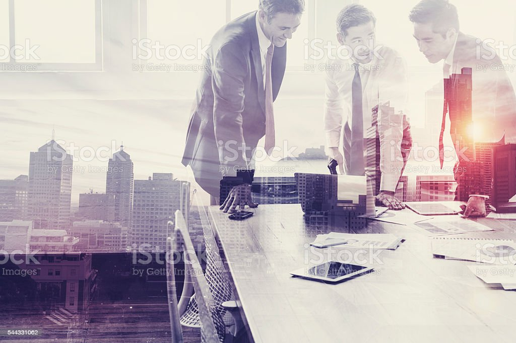 Group of business people working with technology. stock photo
