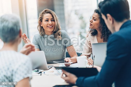 istock Group of business persons in discussion 905746192