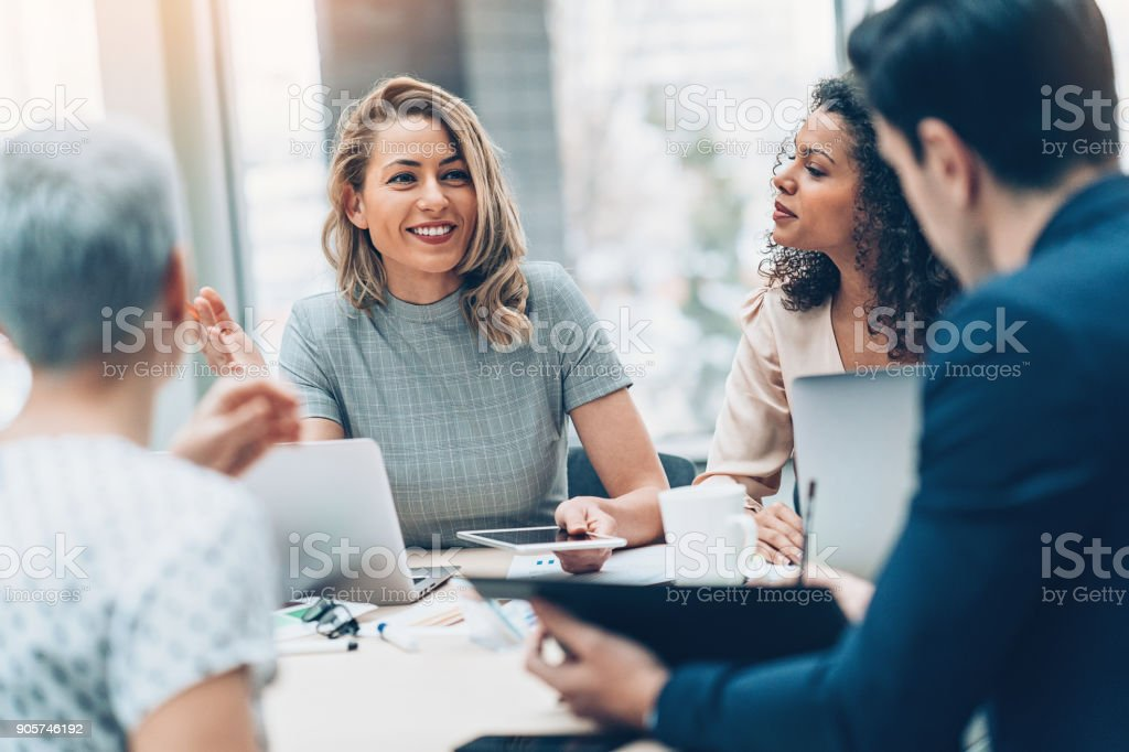 Group of business persons in discussion stock photo