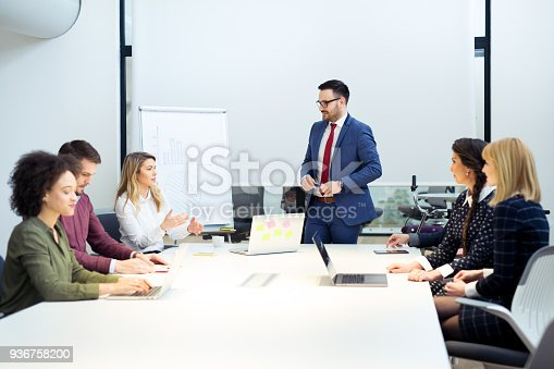 istock Group of business persons in discussion 936758200