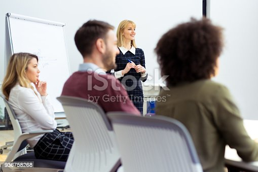 istock Group of business persons in discussion 936758268