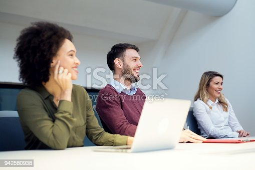 istock Group of business persons in discussion 942580938