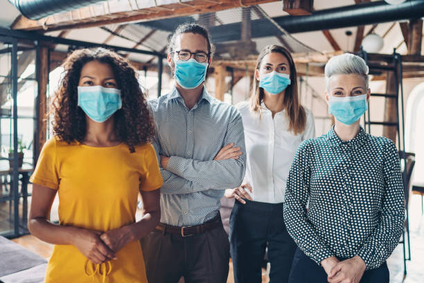 Group of business persons with face masks stock photo