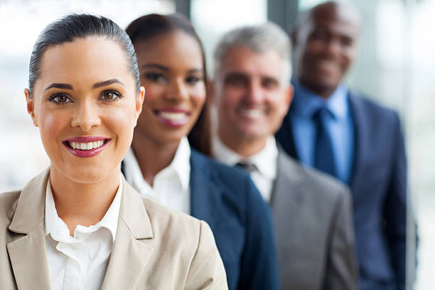 group of business team standing in a row - row of heads stock photos and pictures