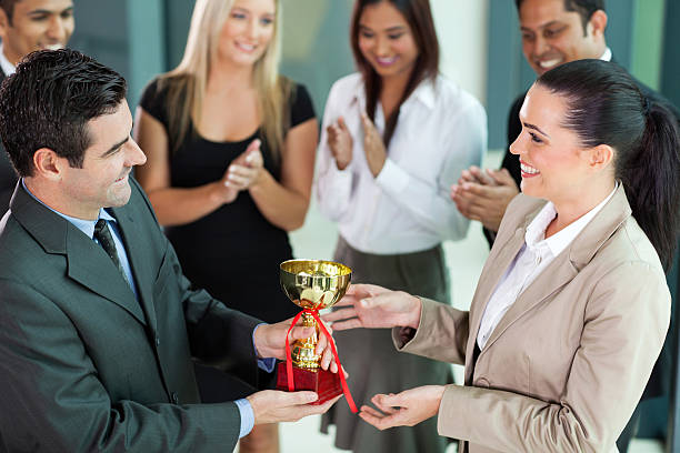 group of business team winning a trophy - receiving stock photos and pictures