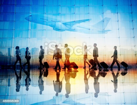 istock Group of Business Travellers Walking in an Airport 488868069