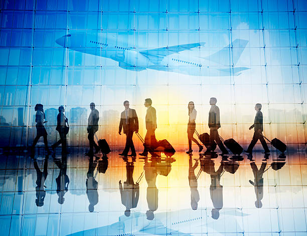 Group of Business Travellers Walking in an Airport stock photo