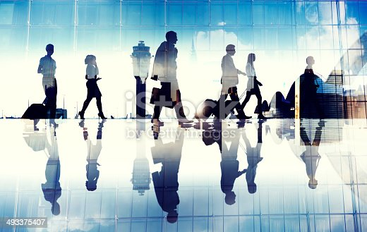 istock Group of Business Travellers Walking in the Airport 493375407