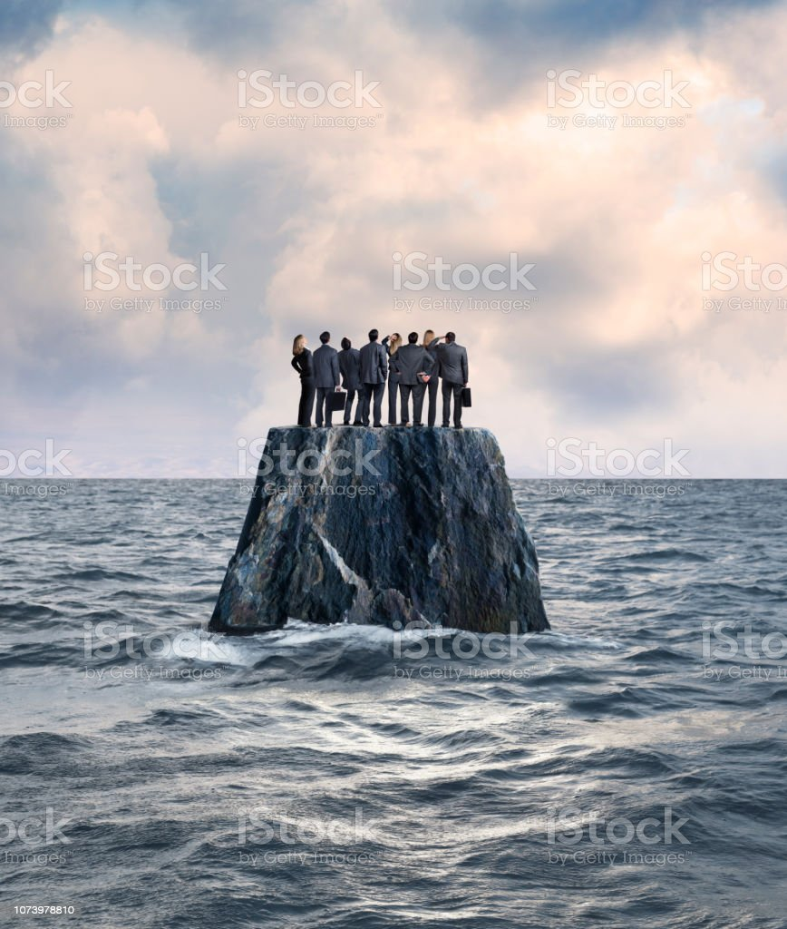 Group Of Businessman And Businesswoman Stand On Isolated Island In Ocean stock photo