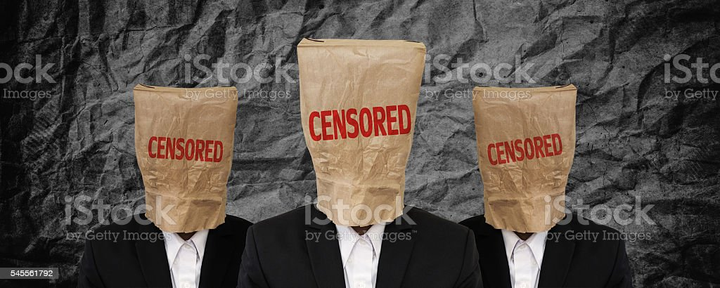 Group of businessman, brown paper bag on head with 'CENSORED' stock photo