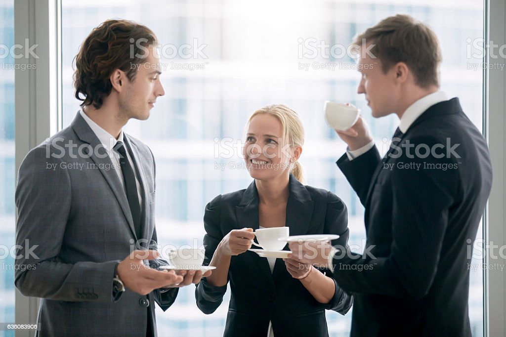 Group of businessmen having tea after meeting royalty-free stock photo
