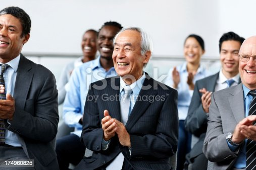 600073884 istock photo Group of businesspeople applauding a convention 174960825