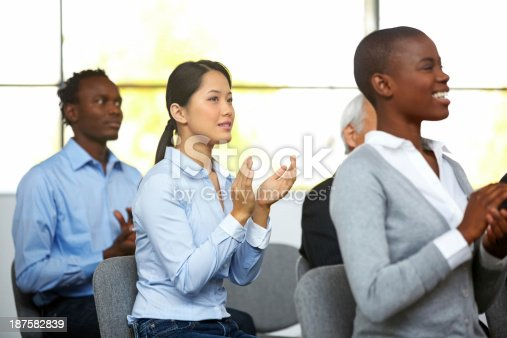 505413934 istock photo Group of businesspeople applauding a seminar 187582839