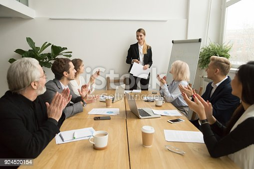 924519152 istock photo Group of businesspeople applauding team leader after presentation 924520154