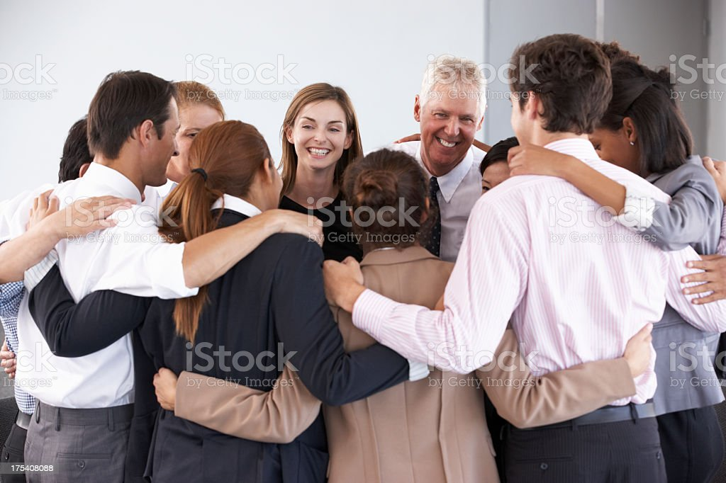 Group Of Businesspeople Bonding In Circle At Company Seminar stock photo