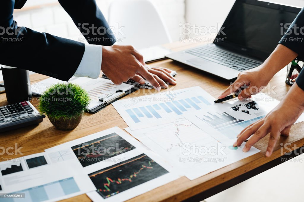 Group of Businesspeople discussing the charts and graphs,businessmen discussing on stockmarket document in office,Business partners consult documents at meeting,Concept of brainstorm teamwork planning Group of Businesspeople discussing the charts and graphs,businessmen discussing on stockmarket document in office,Business partners consult documents at meeting,Concept of brainstorm teamwork planning Accountancy Stock Photo