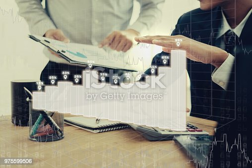 975599364istockphoto Group of Businesspeople discussing the charts and graphs,businessmen discussing on stockmarket document in office,Business partners consult documents at meeting,Concept of brainstorm teamwork planning 975599506