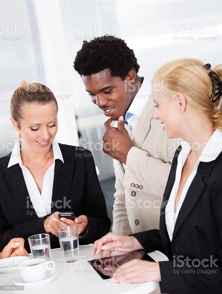 Group Of Businesspeople Discussing Together stock photo