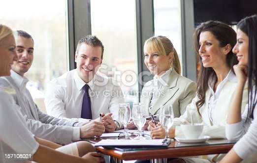 669854210 istock photo Group of businesspeople having a meeting. 157108021