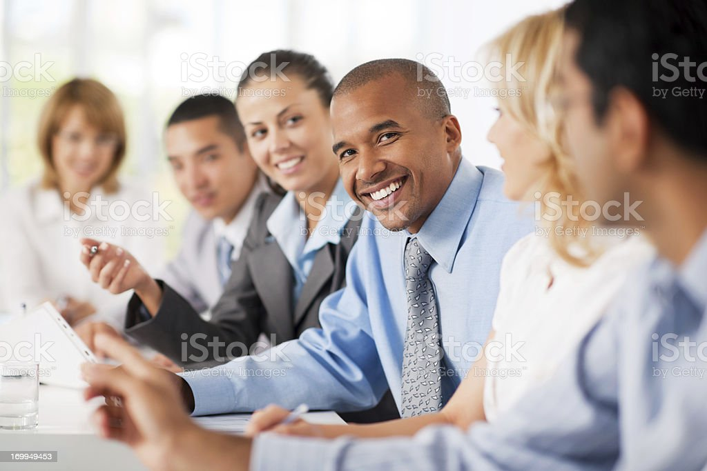 Group of businesspeople having a meeting. stock photo