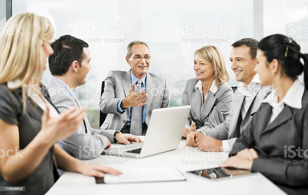 Group of businesspeople having a meeting royalty-free stock photo