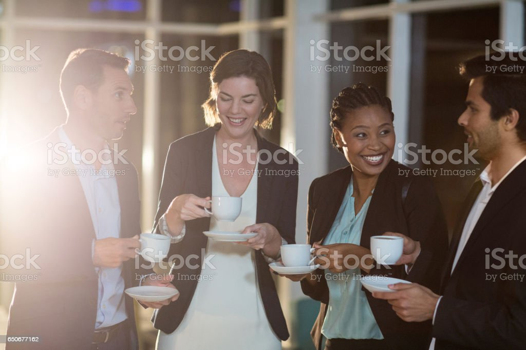 Group of businesspeople having coffee during break royalty-free stock photo