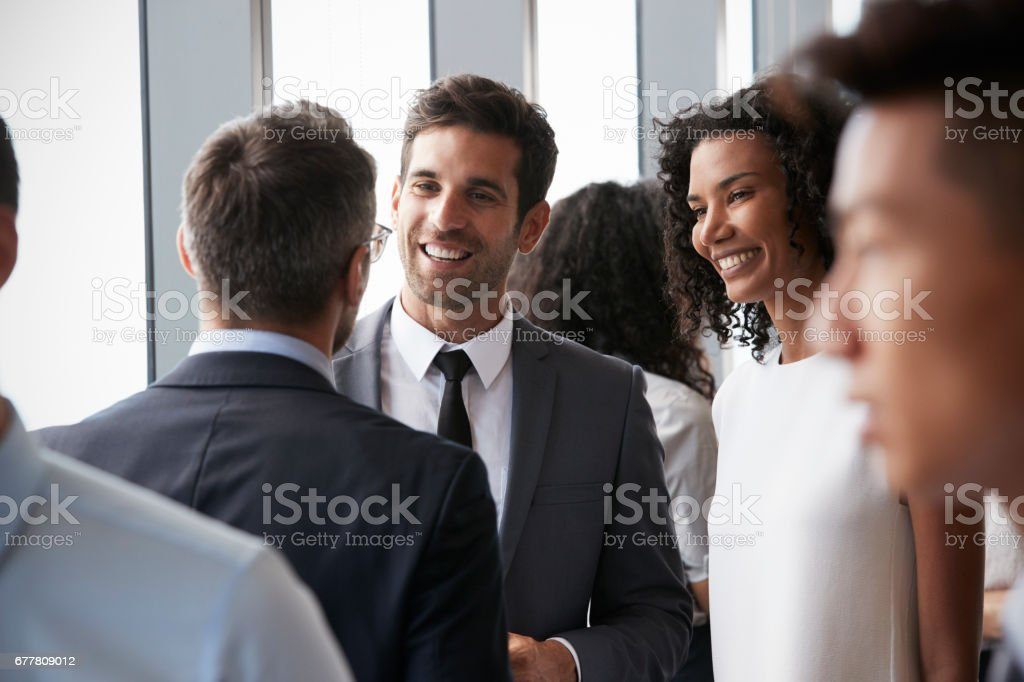 Group Of Businesspeople Having Informal Office Meeting stock photo