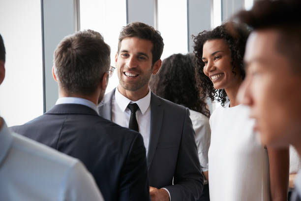 Group Of Businesspeople Having Informal Office Meeting Group Of Businesspeople Having Informal Office Meeting event stock pictures, royalty-free photos & images