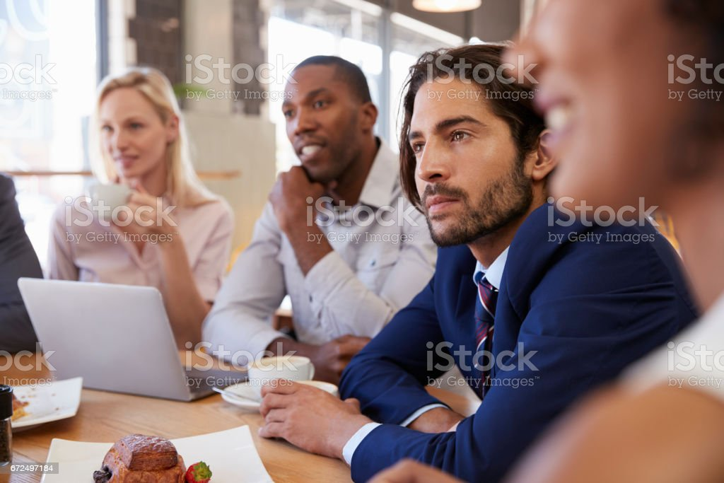 Group Of Businesspeople Having Meeting In Coffee Shop royalty-free stock photo