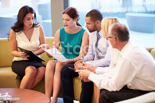 504879112istockphoto Group Of Businesspeople Having Meeting In Office Lobby 469667455