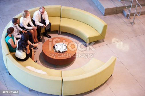 504879112istockphoto Group Of Businesspeople Having Meeting In Office Lobby 469682441