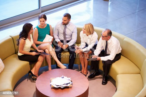 504879112istockphoto Group Of Businesspeople Having Meeting In Office Lobby 469682781