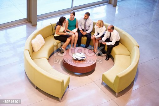 504879112istockphoto Group Of Businesspeople Having Meeting In Office Lobby 469716401