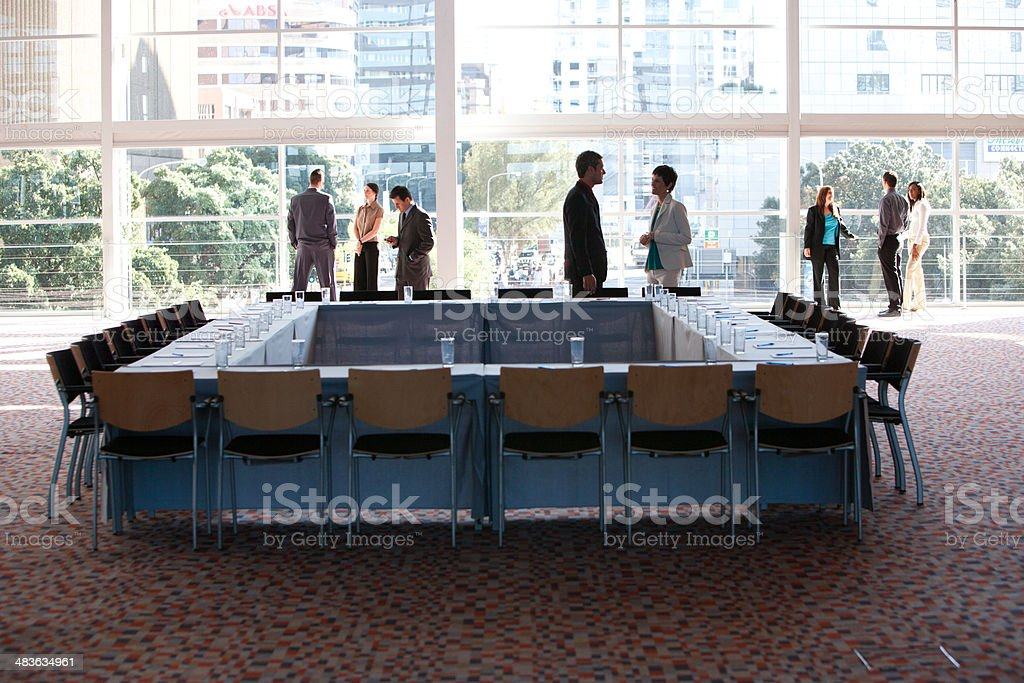 Group of businesspeople in meeting room with large window stock photo