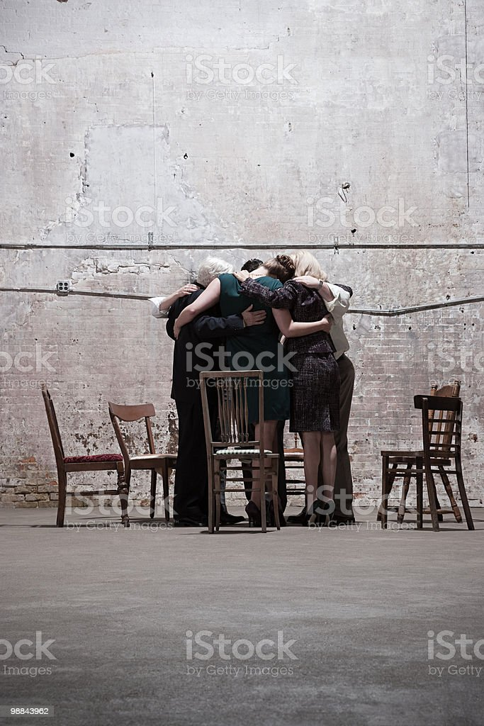 Group of businesspeople in warehouse royalty-free stock photo