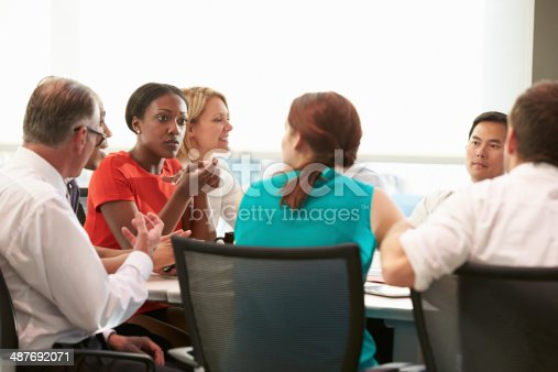 504879112istockphoto Group Of Businesspeople Meeting Around Boardroom Table 487692071