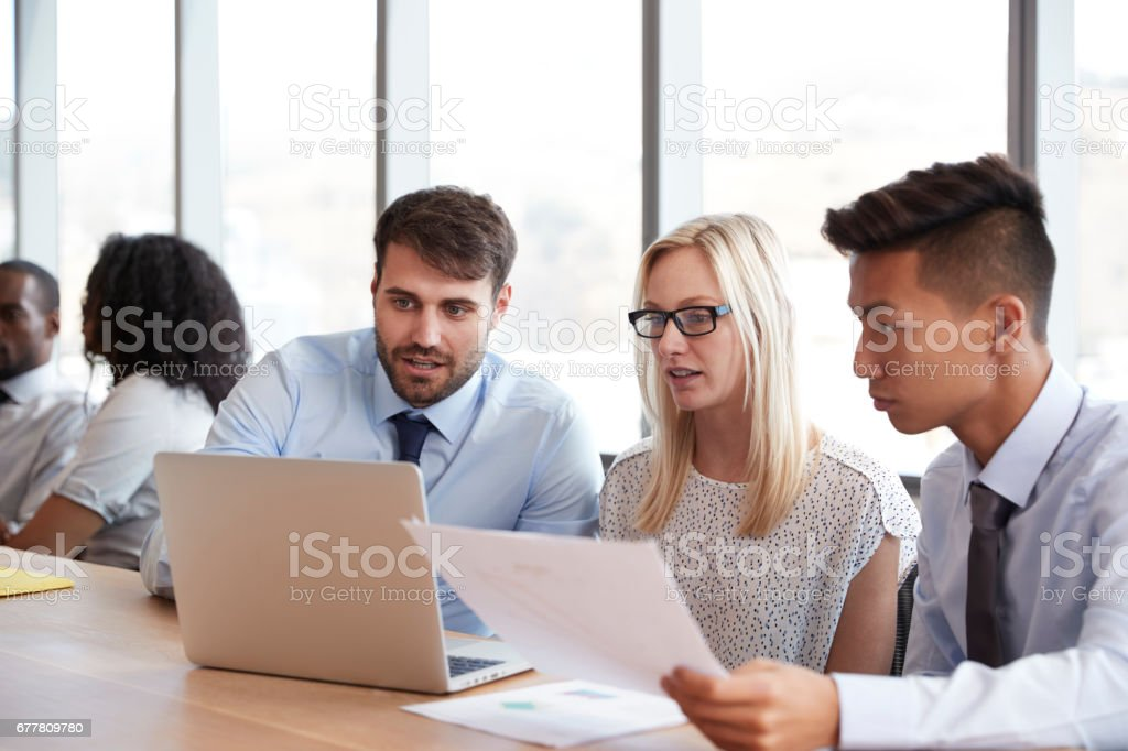 Group Of Businesspeople Meeting Around Table In Boardroom royalty-free stock photo