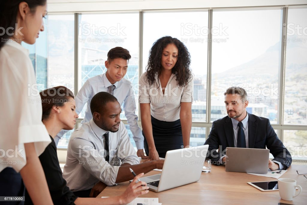 Group Of Businesspeople Meeting Around Table In Office royalty-free stock photo