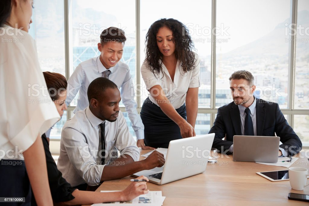 Group Of Businesspeople Meeting Around Table In Office stock photo