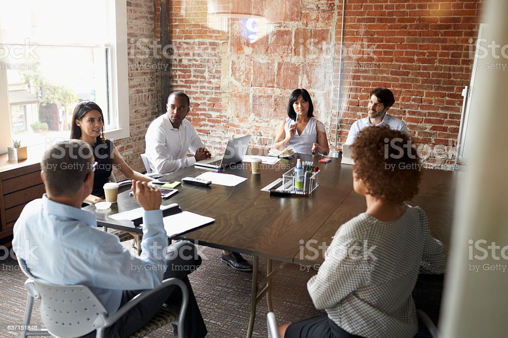 Group Of Businesspeople Meeting In Modern Boardroom - Royalty-free 20-29 Years Stock Photo