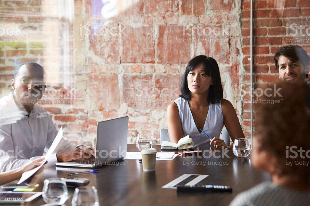 Group Of Businesspeople Meeting In Modern Boardroom royalty-free stock photo