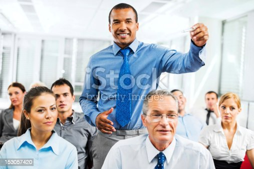 640177838 istock photo Group of businesspeople on a seminar. 153057420