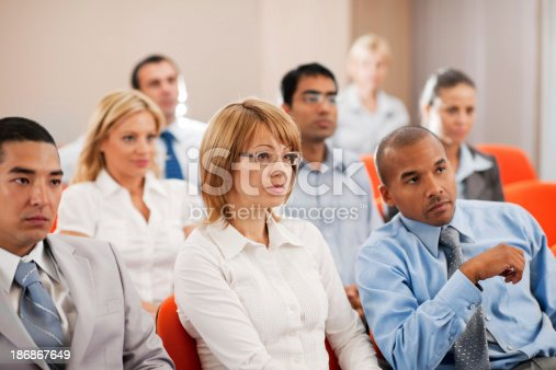 829570660 istock photo Group of businesspeople on a seminar. 186867649