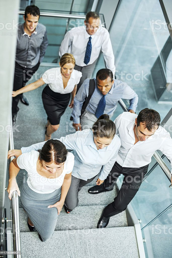 Group of businesspeople on the staircase. royalty-free stock photo