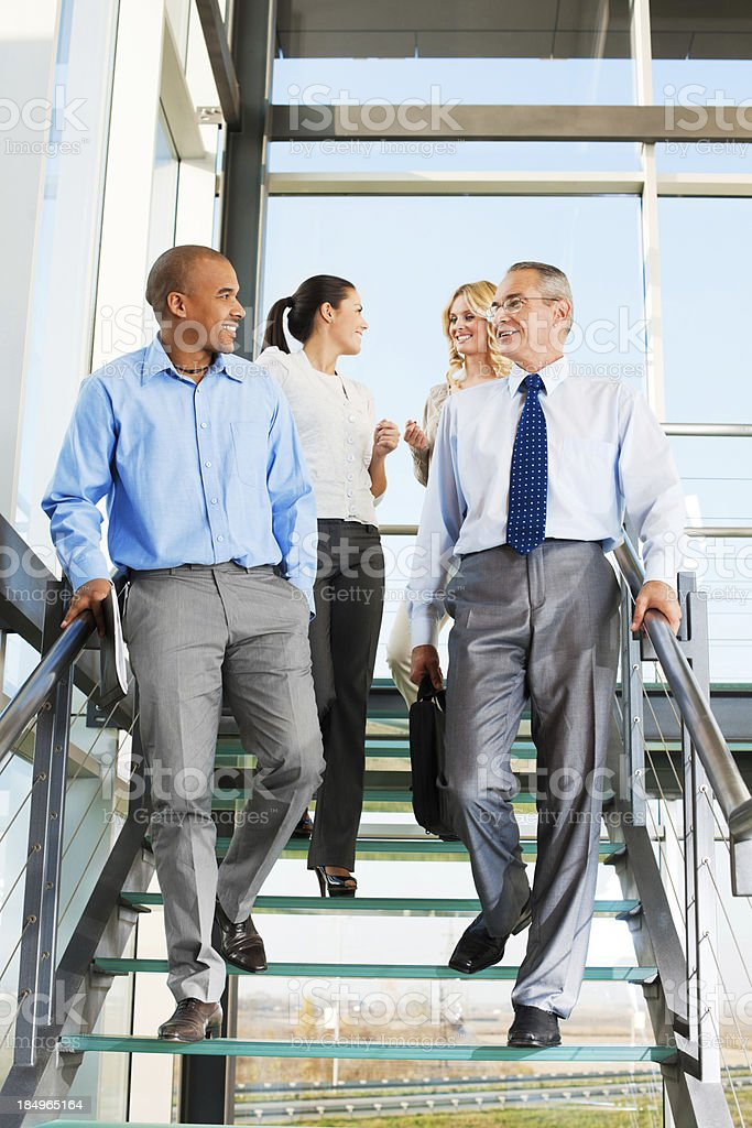 Group of businesspeople people on the staircase. stock photo