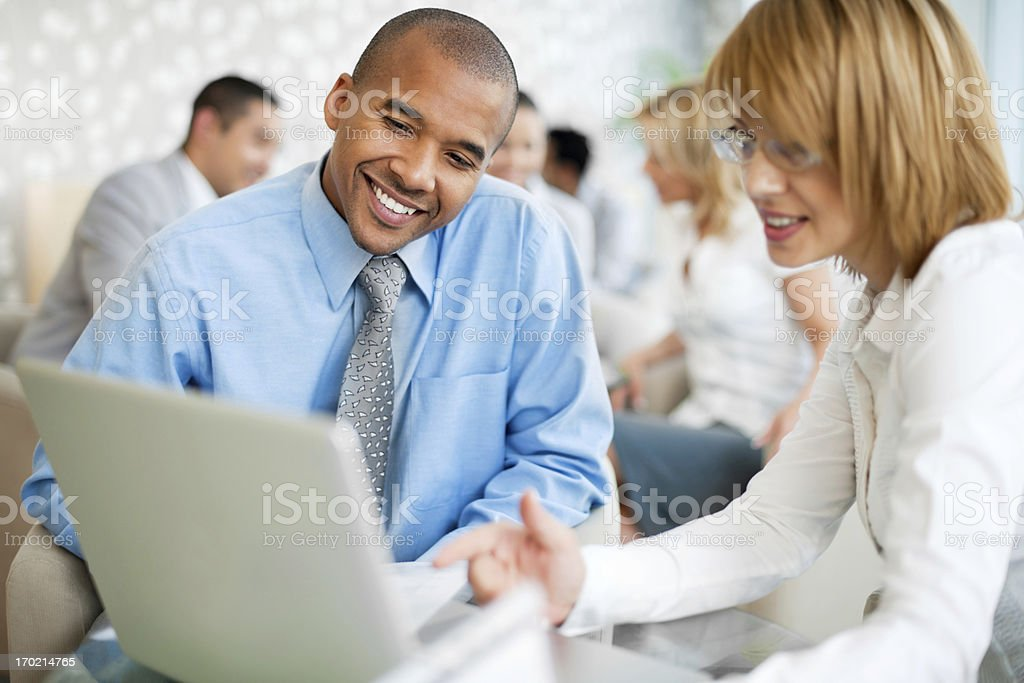 Group of businesspeople sitting and working together royalty-free stock photo