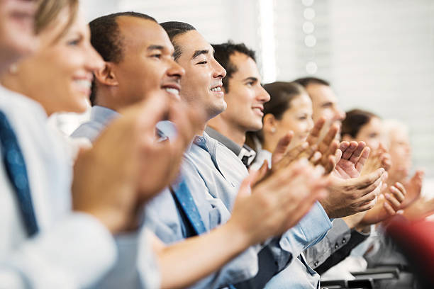 group of businesspeople sitting in a line and applauding. - audience clapping stock photos and pictures