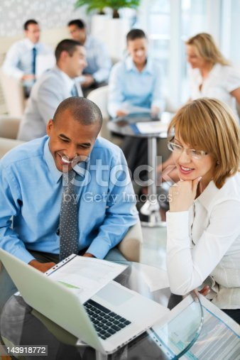 669854210 istock photo Group of businesspeople sitting working together. 143918772